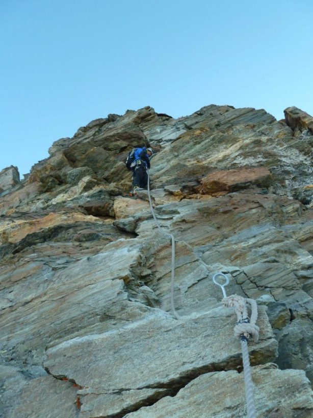 Descending fixed ropes at the top of the Hornli. © Tom Grant