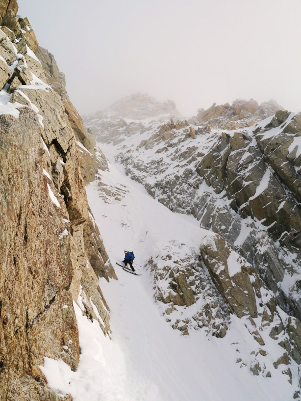 Tom on the exposed traverse, the only hard snow all day.