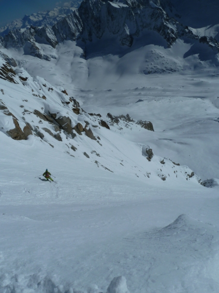 Skiing down to the exit couloir. © Tom Grant