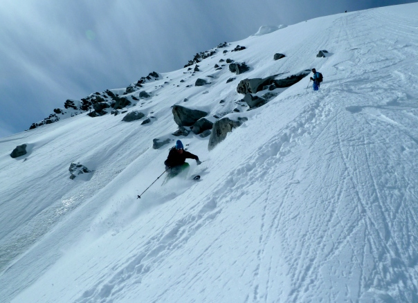 Ben skiing down to the crux. © Tom Grant