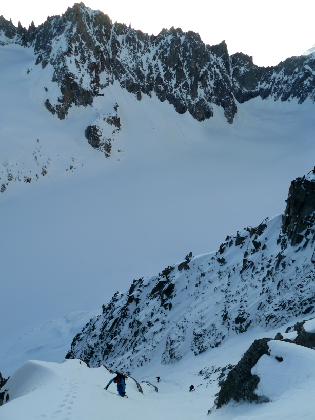 Ross, Luca and Mikko climbing the entry couloir.  © Tom Grant