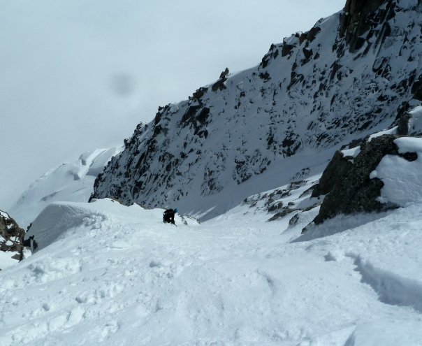 Ben joining the exit couloir. © Tom Grant