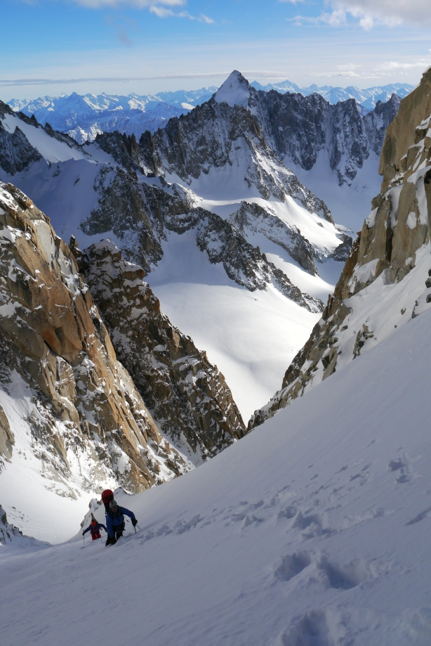 Brendan and Tom nearing the top of the couloir, with Mont Dolent in the background.